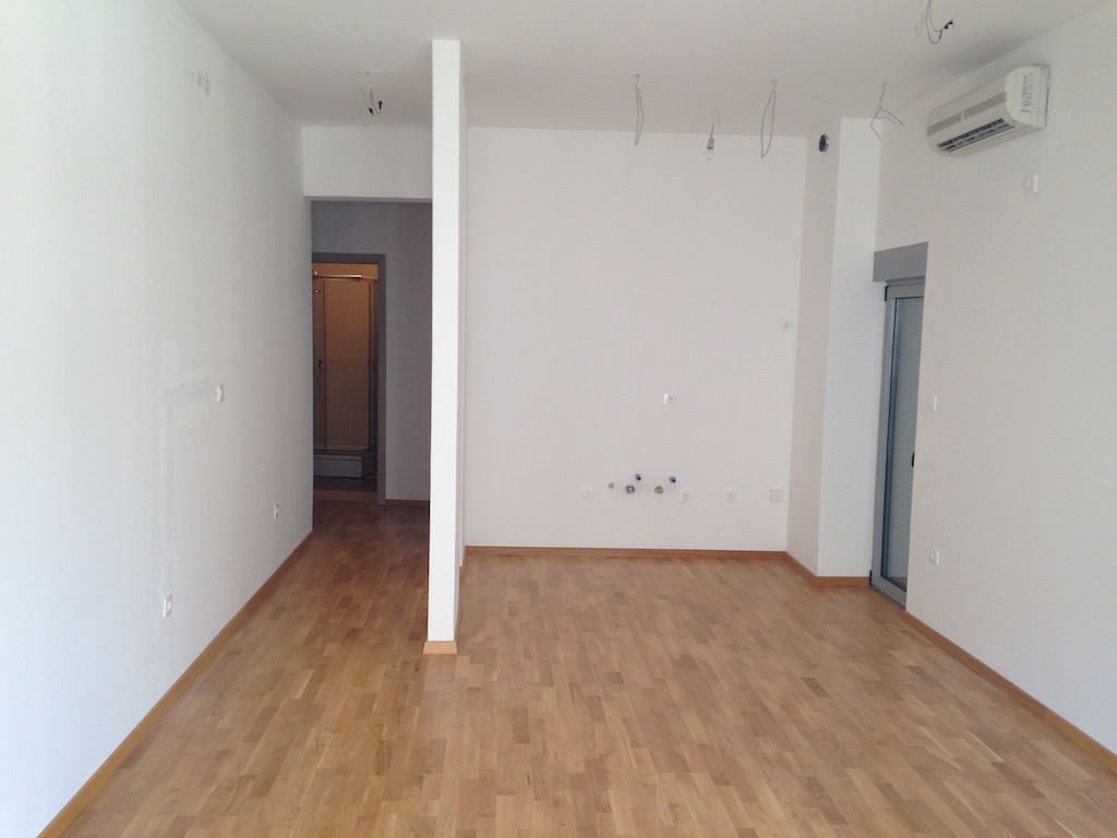 Apartment in a new building next to the seafront in Becici