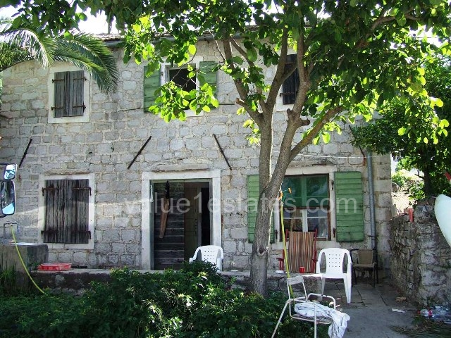 Old stone house on the waterfront of Kotor Bay