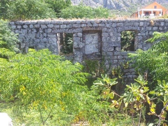 Ruins on waterfront in Kotor Bay